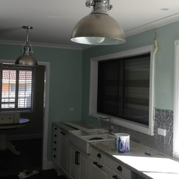 This kitchen's walls were covered in a cool mint to compliment the modern look that the owners were after.