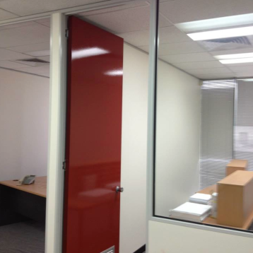 This office was refreshed with a few coats of gloss red on the office doors.